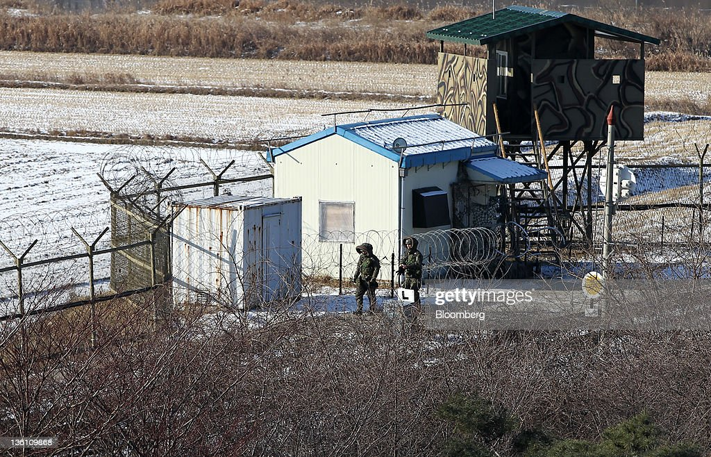 South Korean soldiers patrol along a barbedwire fence at the Imjingak Pavilion near the Demilitarized Zone in Paju South Korea on Monday Dec 26 2011...