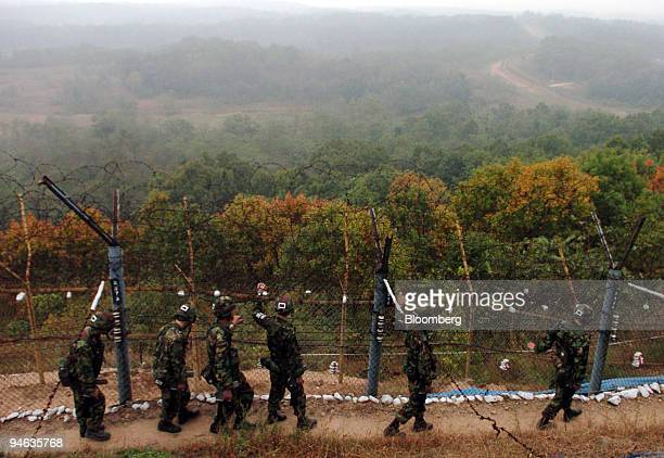 South Korean soldiers patrol an electric barbwire fence at the demilitarized zone which separates the two Koreas in Paju north of Seoul South Korea...