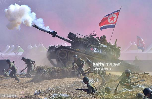 South Korean soldiers play the roles of both South Korean forces and invading North Korean soldiers during a reenactment of the 1950 battle of...