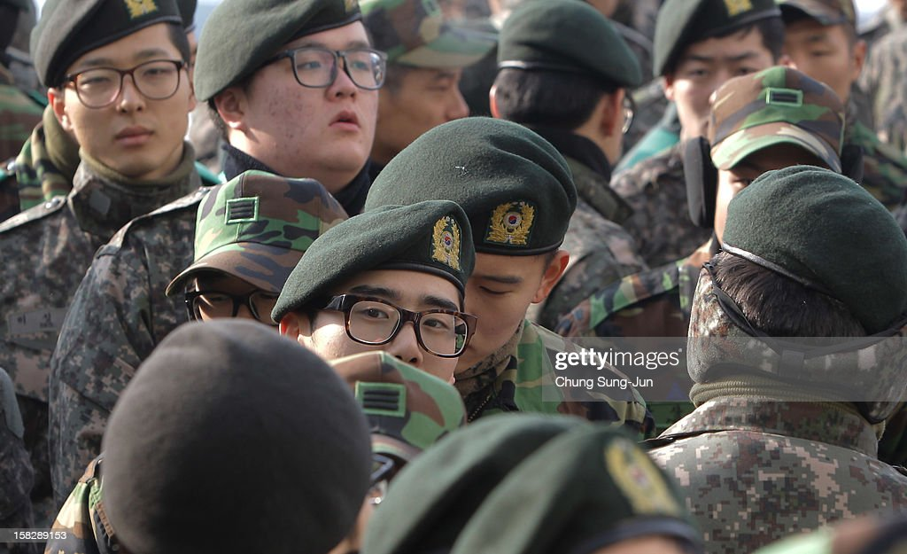 South Korean soldiers queue up to cast their absentee ballots for new President in a polling station on December 13, 2012 in Seoul, South Korea. South Koreans vote in the presidential election on December 19.