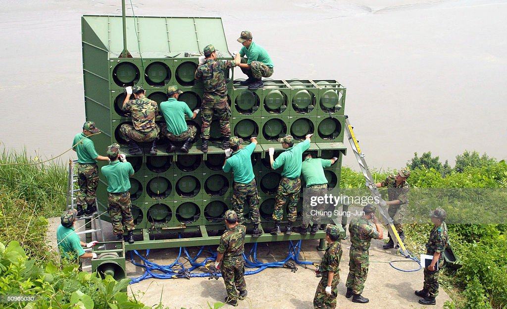 South Korean soldiers remove a battery of propaganda loudspeakers on the border with North Korea on 16 June 2004 in Paju South Korea The removal of...