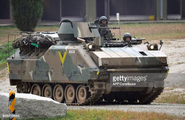 South Korean soldiers ride on an armoured vehicle during a South KoreaUS combined arms collective training exercise at the US army's Rodriguez...