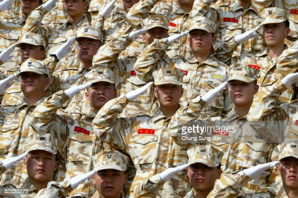 South Korean soldiers salute during a farewell ceremony before their dispatch to Iraq on February 24 2005 at the military base in Gwangju South Korea...
