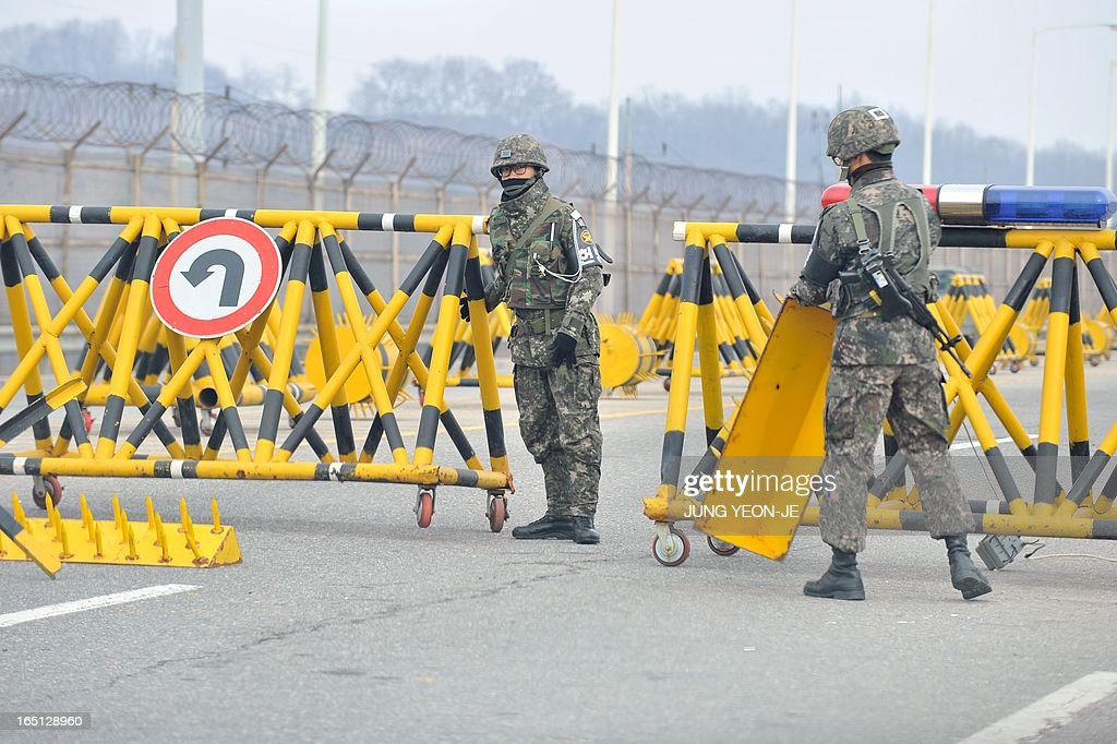 South Korean soldiers set barricades at a military check point on the road linked to North Korea in Paju near the Demilitarized Zone (DMZ) on April 1, 2013. South Korean workers and cargo on April 1 headed for the Kaesong Industrial Complex without a hitch despite North Korea's recent threat to close the joint industrial zone in the communist country.