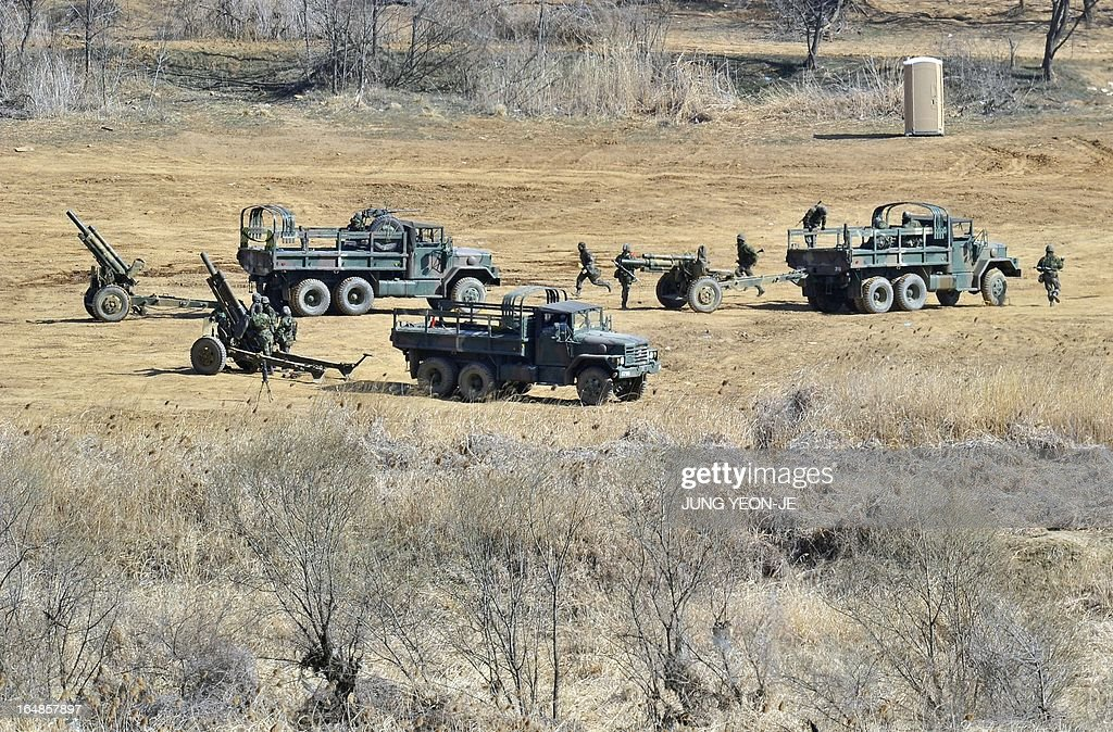 South Korean soldiers set their cannons at a military training field in the border city of Paju on March 29, 2013. North Korean leader Kim Jong-Un ordered preparations on March 29, for strategic rocket strikes on the US mainland and military bases after US stealth bombers flew training runs over South Korea. AFP PHOTO / JUNG YEON-JE