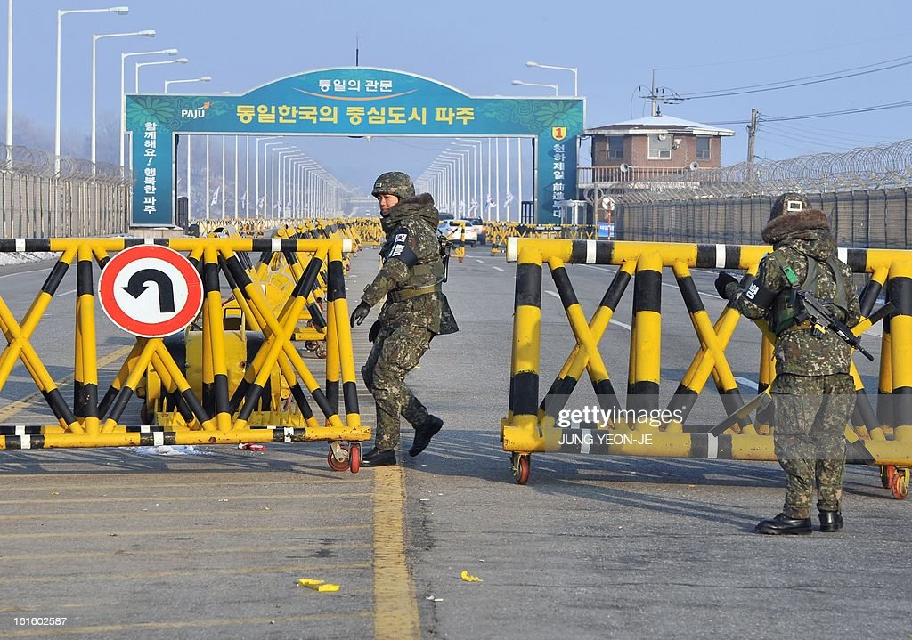 South Korean soldiers set up barricades across the road linking North Korea's Kaesong Industrial Complex at a military check point in Paju near the demilitarized zone dividing the two Koreas on February 13, 2013. North Korea on February 12 staged its most powerful nuclear test yet and warned of 'stronger' action to follow if the ensuing wave of global condemnation translated into tougher sanctions.