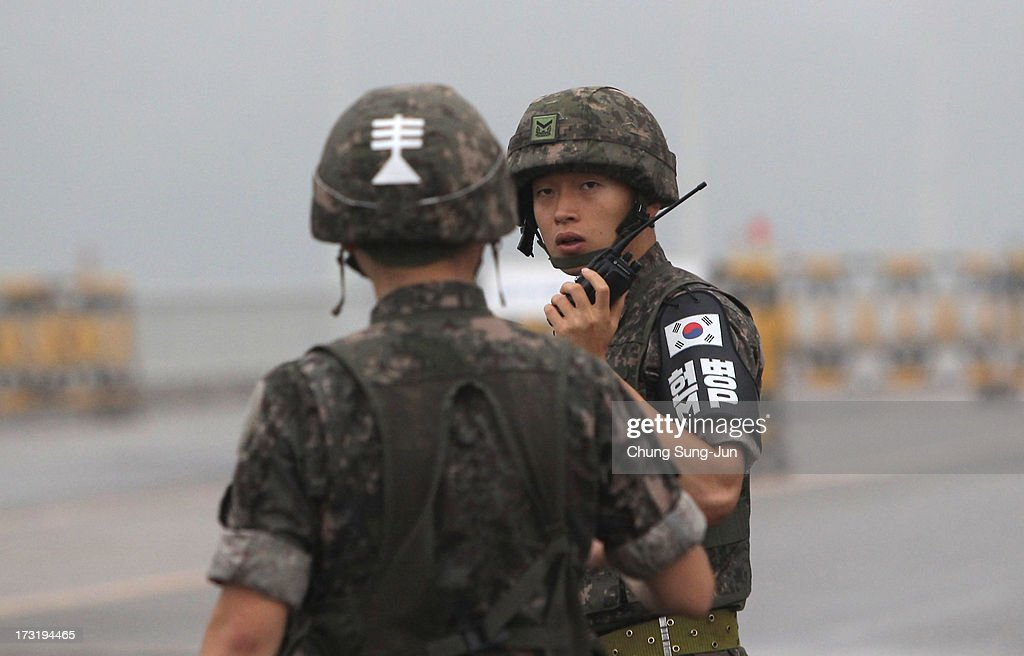 South Korean soldiers stand at a military check point connecting South and North Korea at the Unification Bridge on July 10, 2013 in Paju, South Korea. Government officals and business leaders from North and South Korea will hold talks today to discuss resuming operations at the Kaesong Joint Industrial Park 10 kilometres north of the border. North Korea withdrew over 50,00 of it's staff from the factories owned by Seoul in April of this year, and South Korea removed managers in May, during the height of tensions between the two nations.