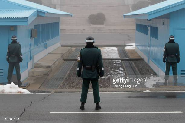 South Korean soldiers stand guard at the border village of Panmunjom between South and North Korea at the Demilitarized Zone on February 27 2013 in...