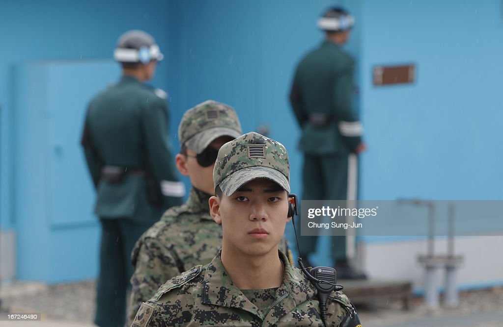 South Korean soldiers stand guard at the border village of Panmunjom between South and North Korea at the Demilitarized Zone (DMZ) on April 23, 2013 in Panmunjom, South Korea. The tension at Korean Peninsula remains high as North Korea's ballistic missiles have been ready to launch ahead of North Korean Army foundation celebration day on April 25.
