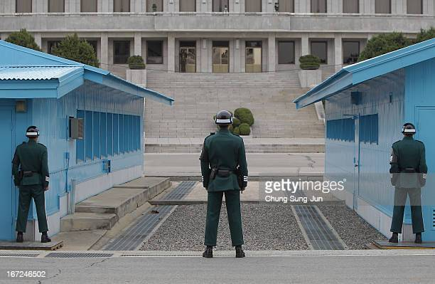 South Korean soldiers stand guard at the border village of Panmunjom between South and North Korea at the Demilitarized Zone on April 23 2013 in...