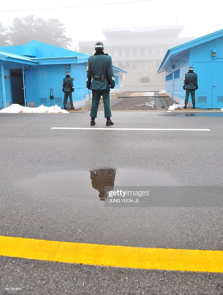 South Korean soldiers stand guard in fog at the truce village of Panmunjom in the demilitarized zone dividing North and South Korea on February 27, 2013. North Korean leader Kim Jong-Un oversaw a live-fire artillery drill aimed at simulating an 'actual war', state media said on February 26, a day after South Korea swore in its first female president.
