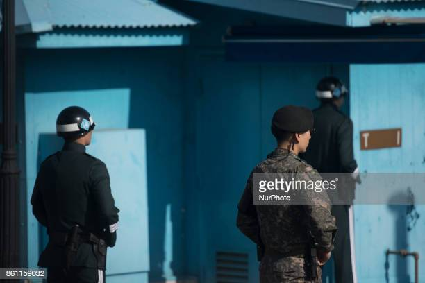 South Korean soldiers stand guard in the border village of Panmunjom between South and North Korea at the Demilitarized Zone on October 14 2017 in...