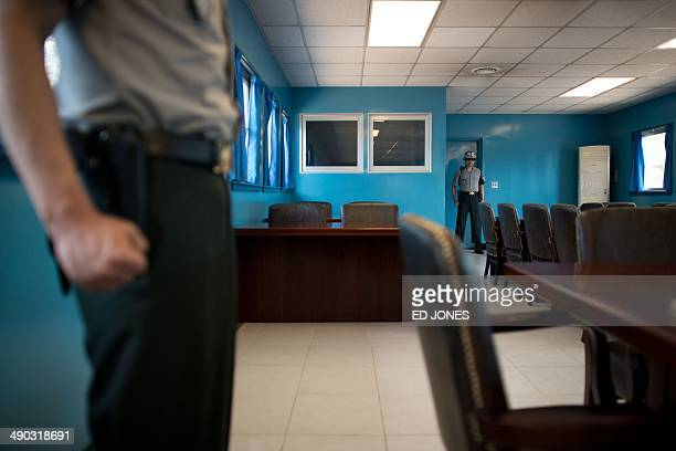 South Korean soldiers stand guard inside a military armistice committee meeting room at the truce village of Panmunjom in the Demilitarized Zone...