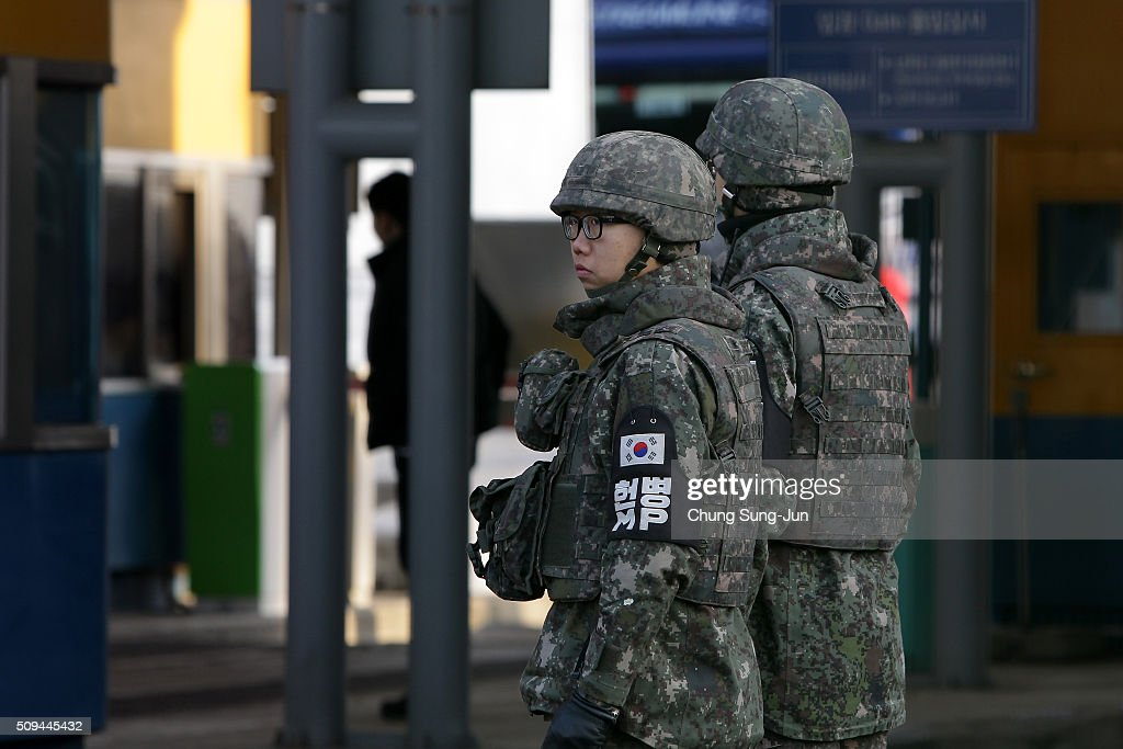 South Korean soldiers stand guard on patrol at the customs, immigration and quarantine (CIQ) office on February 11, 2016 in Paju, South Korea. South Korea announced on February 10, 2016 that the country would close an industrial complex jointly ran with North Korea, as the strongest response for North's recent nuclear test and rocket launch.
