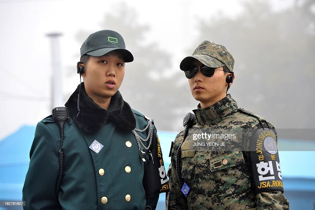 South Korean soldiers stands guard as journalists visit the truce village of Panmunjom in the demilitarized zone dividing North and South Korea on February 27, 2013. North Korean leader Kim Jong-Un oversaw a live-fire artillery drill aimed at simulating an 'actual war', state media said on February 26, a day after South Korea swore in its first female president.