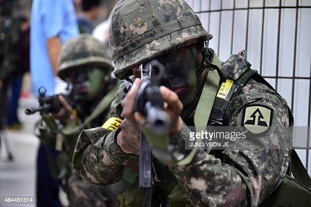 South Korean soldiers take a position during an antiterror drill on the sidelines of South KoreaUS joint military exercise called Ulchi Freedom...