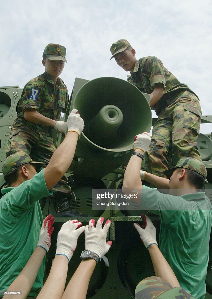 South Korean soldiers take down a battery of propaganda loudspeakers on the border with North Korea on 16 June 2004 in Paju South Korea The removal...
