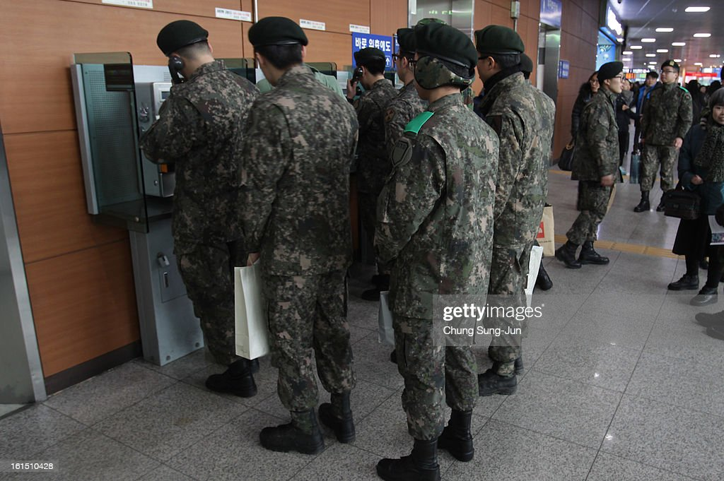 South Korean soldiers use public phones at Seoul railway Station on February 12, 2013 in Seoul, South Korea. North Korea confirmed it had successfully carried out an underground nuclear test, as a shallow earthquake with a magnitude of 4.9 was detected by several international monitoring agencies. South Korea and Japan both assembled an emergency meeting of their respective national security teams after the incident.