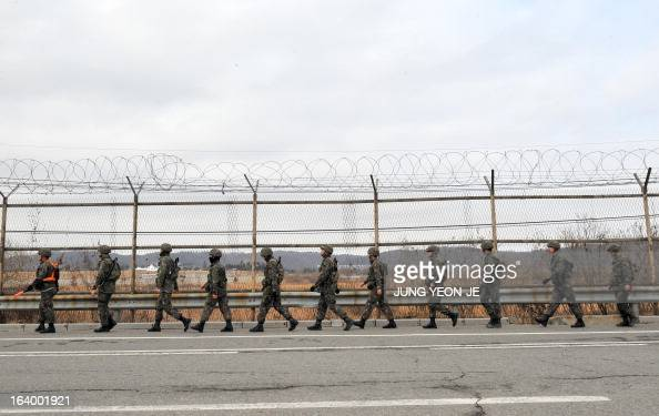 South Korean soldiers walk along an iron fence near a military check point in the border city of Paju on March 19 2013 The US on March 19 said it was...