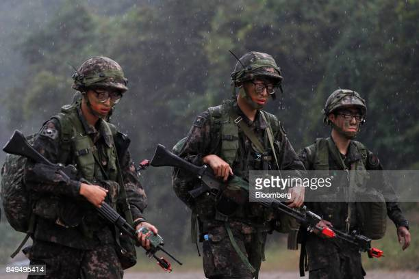 South Korean soldiers walk as rain falls during Warrior Strike VIII a bilateral training exercise between the US Army's 2nd Armored Brigade Combat...