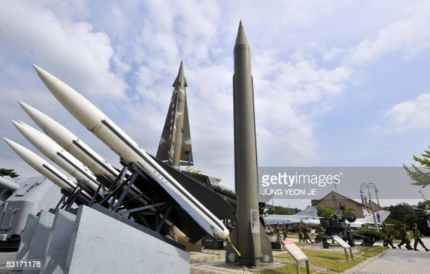 South Korean soldiers walk past replicas of North Korea's ScudB missile and other South Korean missiles at the Korea War Memorial Museum in Seoul on...