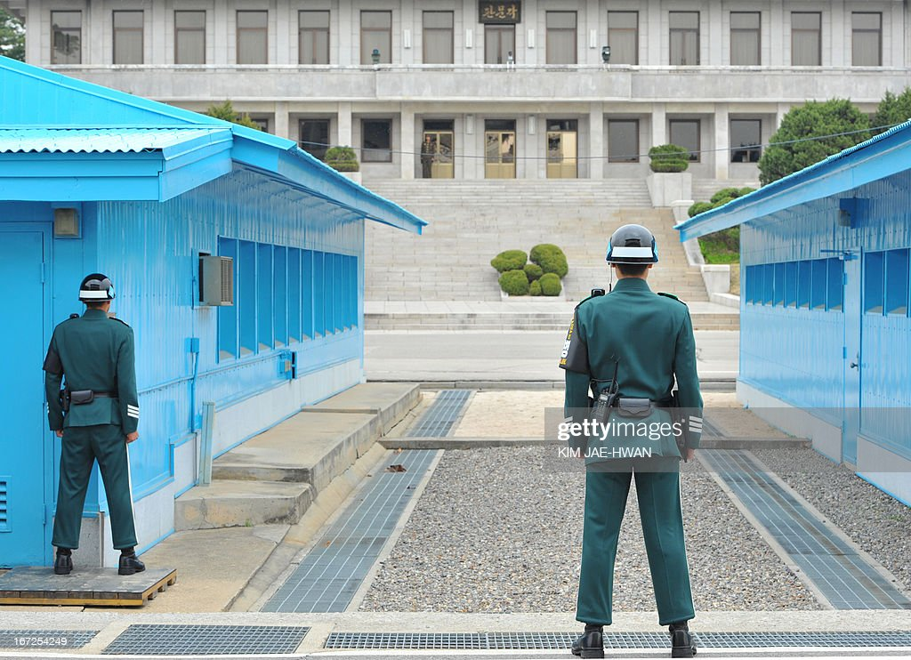 South Korean soldiers watch a North Korean building at the truce village of Panmunjom in the demilitarised zone on April 23, 2013. Tensions simmer along the world's last Cold War frontier after weeks of hostile threats from North Korea and its preparations for potential missile launches.