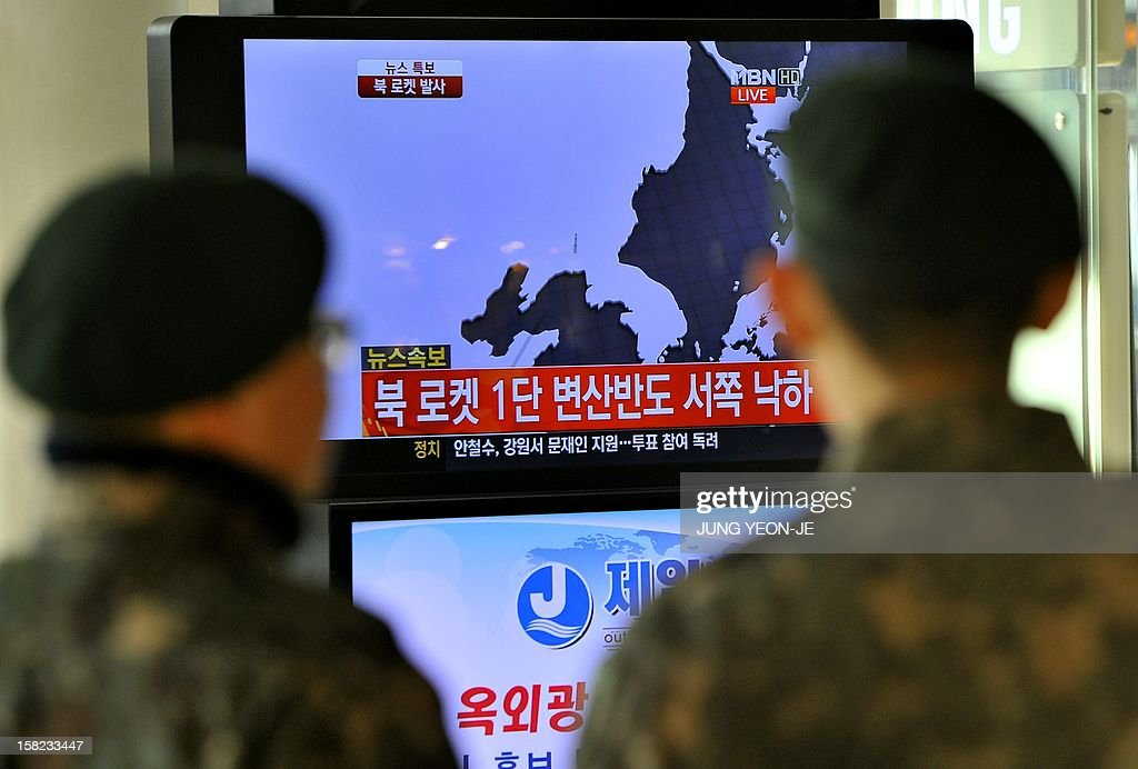 South Korean soldiers watch a TV screen broadcasting news on North Korea's rocket launch, at a railway station in Seoul on December 11, 2012. North Korea on December 12 launched a long-range rocket which Japanese authorities said passed over its southern island chain of Okinawa. It was the second launch this year, after a failed attempt in April.