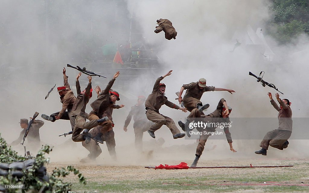 South Korean soldiers wear North Korea's military uniforms, acting as North Korean soldiers, as they take part in a re-enactment the battle of the Korean war during a commemorative war victory event to mark the 63rd anniversary of the the Korean war on June 22, 2013 in Chuncheon, South Korea. Korean soldiers participated in the event alongside the Korean war veterans.