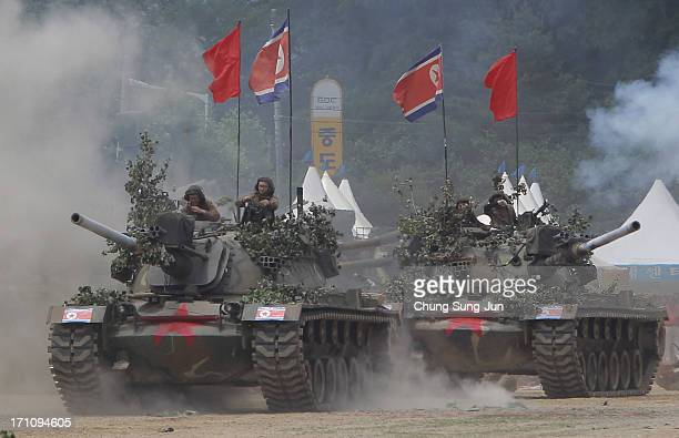 South Korean soldiers wear North Korea's military uniforms acting as North Korean soldiers as they take part in a reenactment the battle of the...