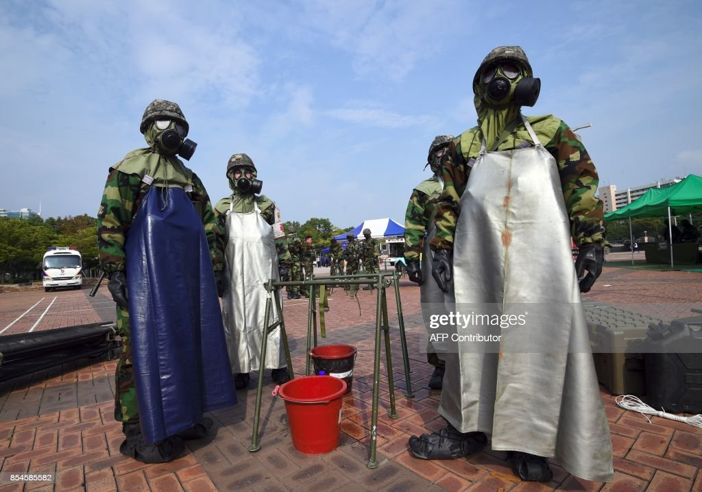 South Korean soldiers wearing chemical protective gears participate in a decontamination training at a stadium in Seoul on September 27, 2017. The training is designed to train their systems and capabilities to increase their preparedness to respond to chemical, biological and nuclear threats. Yeon-Je