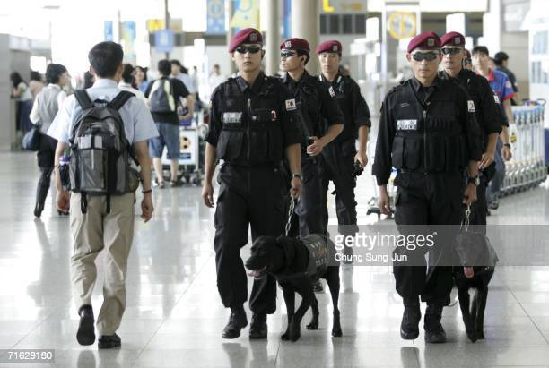 South Korean special police officers patrol around Incheon International Airport on August 11 2006 in Incheon South Korea South Korea tightened...