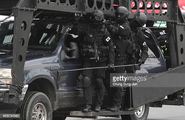 South Korean special police participate in an antiterror drill held by Incheon Metropolitan City around Incheon Asiad Main Stadium on August 6 2014...