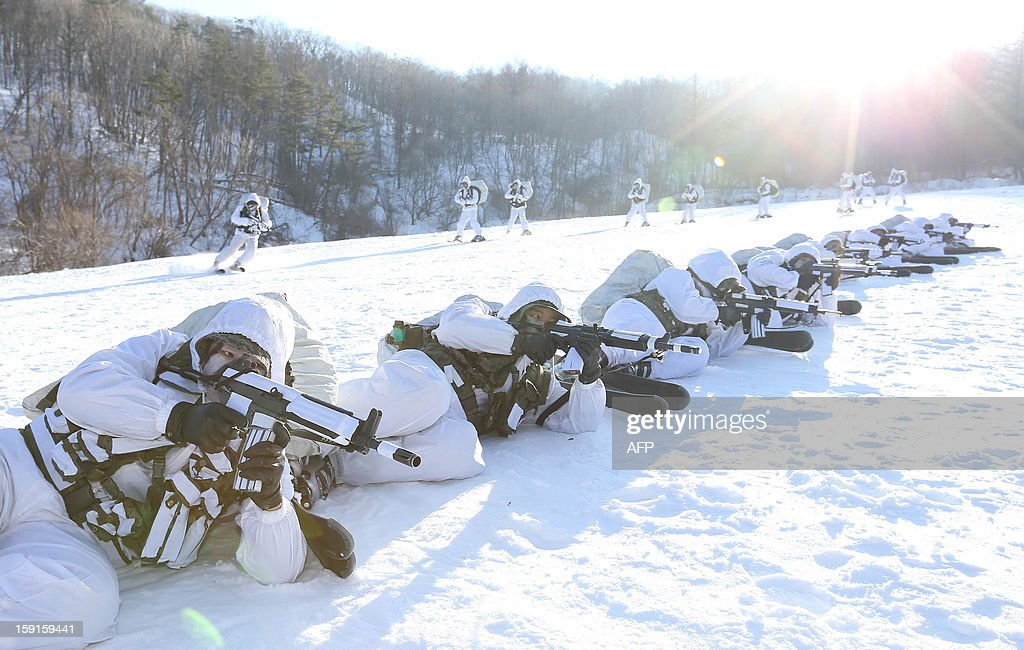 South Korean special warfare forces take part in a winter season drill in Pyeongchang, about 180 km east of Seoul on January 9, 2013. The Korean peninsula is the world's last Cold War frontier as Stalinst North Korea and pro-Western South Korea have been technically at war since the 1950-53 conflict. REPUBLIC OF KOREA OUT AFP PHOTO/DONG-A ILBO