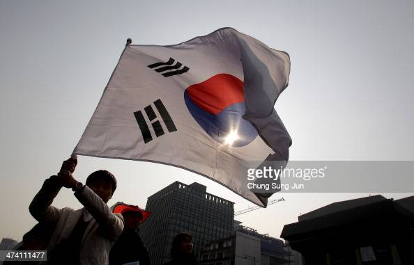 South Korean student waves a national flag during an antiJapan rally on February 22 2014 in Seoul South Korea South Korea and Japan are making claim...
