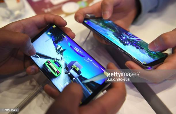 South Korean students play mobile games on Samsung Galaxy S8 smartphones at the company's showroom in Seoul on April 27 2017 South Korean tech giant...