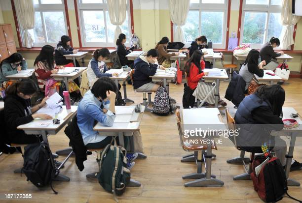 South Korean students prepare to take the College Scholastic Ability Test a standardised exam for college entrance at a high school in Seoul on...