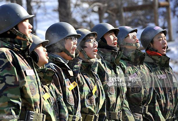 South Korean students shout during a training camp for civilians at a military base of the Special Warfare Command in Bucheon west of Seoul on...