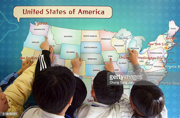 South Korean students study a map of the United States as part of a scheme whereby students can achieve 'full immersion' in the English language...