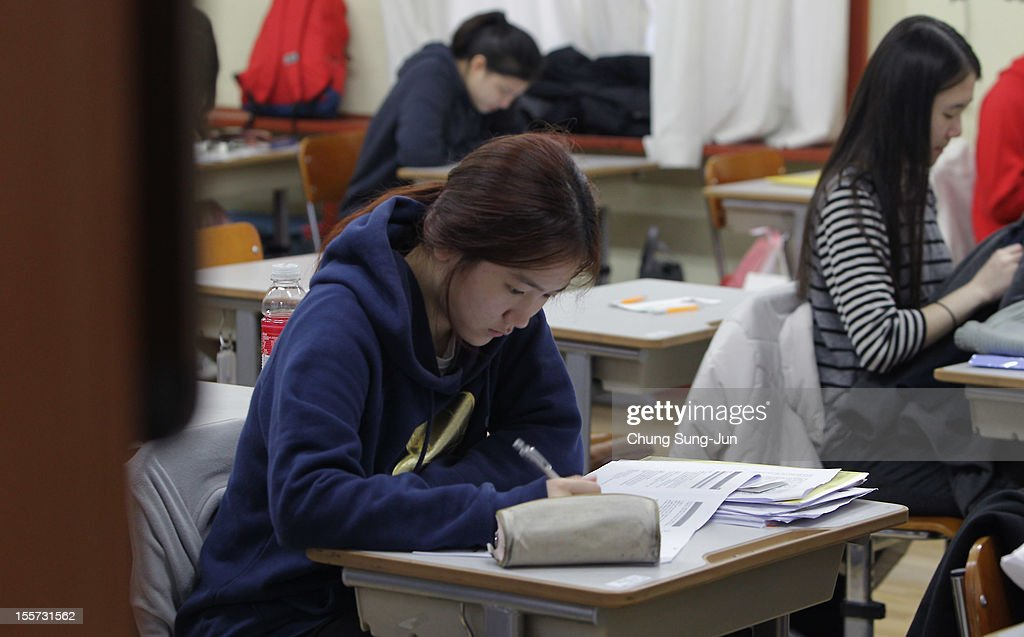 South Korean students take their College Scholastic Ability Test at a school on November 8, 2012 in Seoul, South Korea. More than 660,000 high school seniors and graduates sit for the examinations at 1,100 test centers across the country, where academic records are all important. Success in the exam, one of the most rigourous standardized tests in the world, enables students to study at Korea's top universities.