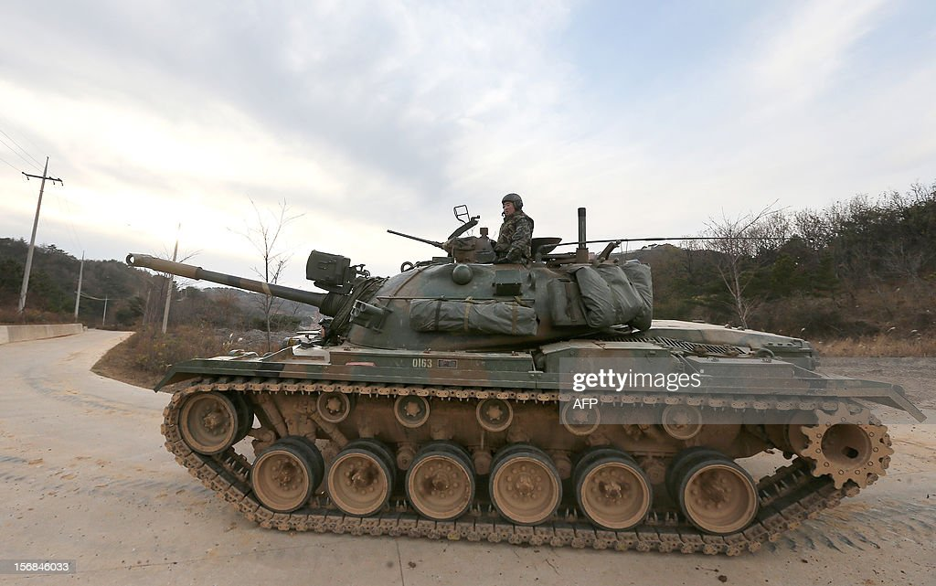A South Korean tank is pictured during an exercise to mark the second anniversary of the North's shelling at Yeonpyeong island on November 23, 2012. South Korea marked on November 23, 2012 the anniversary of North Korea's 2010 shelling of a border island with a military drill and memorials, clouded by the threat of a fresh attack from Pyongyang. REPUBLIC
