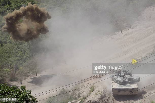 A South Korean tank of the 8th Mechanized Infantry Division takes part in a livefire exercise at a training ground in Cheorwon near the demilitarized...