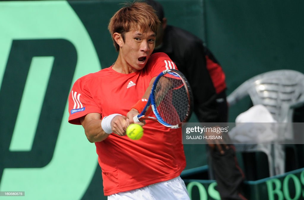 South Korean tennis player Jeong Suk-Young plays a shot against Indian opponent Virali-Murugesan Ranjeet during the reverse singles match of the Davis Cup at the Delhi Lawn Tennis Association (DLTA) courts in New Delhi on February 3, 2013. South Korea won the game 6-4, 6-4, 6-2. AFP PHOTO/ SAJJAD HUSSAIN