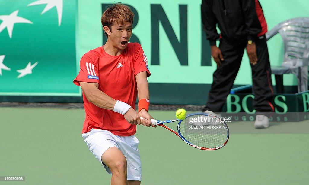 South Korean tennis player Jeong Suk-Young plays a shot against Indian opponent Virali-Murugesan Ranjeet during the reverse singles match of the Davis Cup at the Delhi Lawn Tennis Association (DLTA) courts in New Delhi on February 3, 2013. South Korea won the game 6-4, 6-4, 6-2.