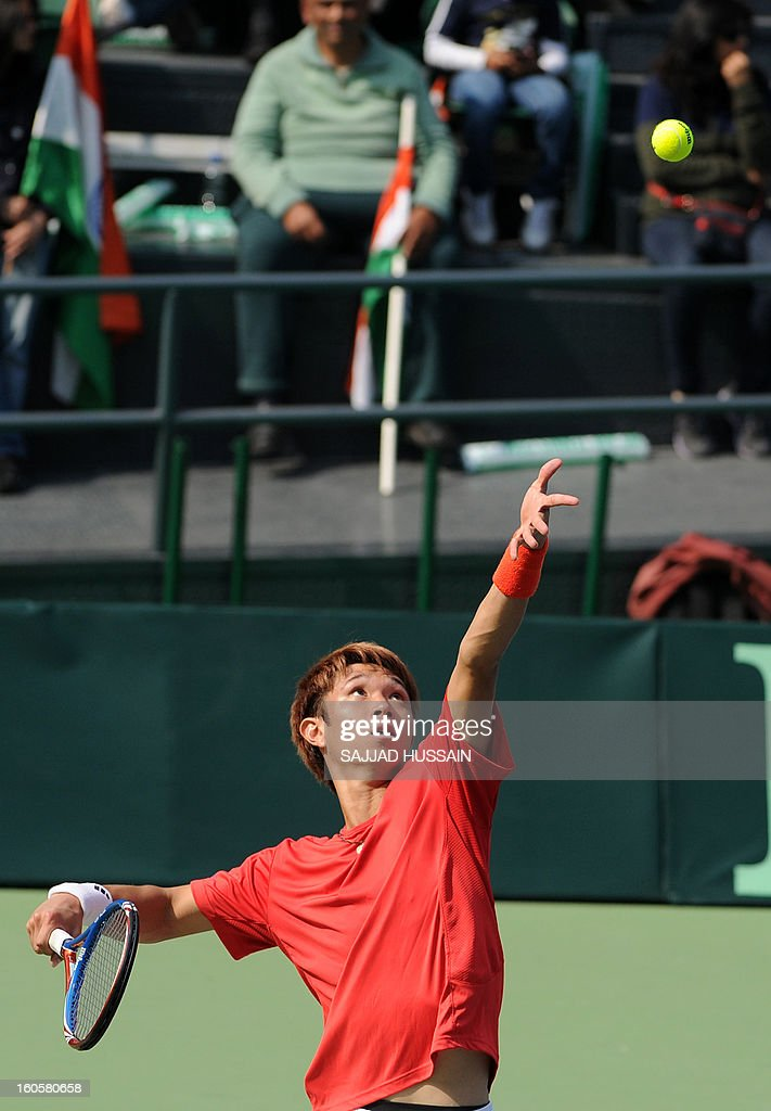 South Korean tennis player Jeong Suk-Young serves against Indian opponent Virali-Murugesan Ranjeet during the reverse singles match of the Davis Cup at the Delhi Lawn Tennis Association (DLTA) courts in New Delhi on February 3, 2013. South Korea won the game 6-4, 6-4, 6-2.