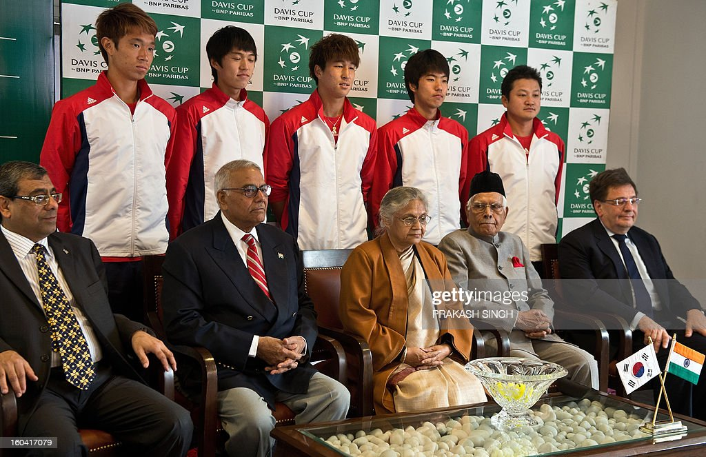 South Korean tennis players Jeong Suk-Young (back-L), Cho Min-Hyeok (back-2L), Lim Yong-Kyu (back-C) and Nam Ji-Sung (back-2R) pose with Delhi Chief Minister Shiela Dikshit (front-C) and former All India Tennis Association (AITA) President Yashwant Sinha (front-2L) after the draw at the Delhi Lawn Tennis Association (DLTA) tennis court in New Delhi on January 31, 2013. India will host South Korea in a Davis Cup Asia/Oceania Group I first round tie match, from February 1-3, 2013. AFP PHOTO/ Prakash SINGH