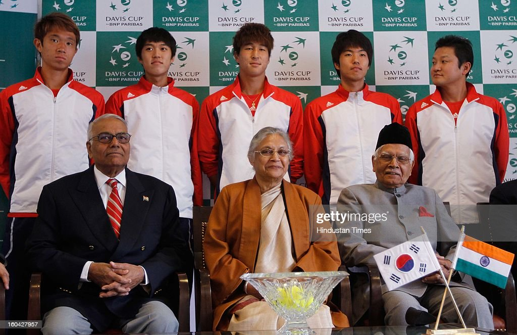 South Korean tennis players Jeong Suk-Young (back-L), Cho Min-Hyeok (back-2L), Lim Yong-Kyu (back-C) and Nam Ji-Sung (back-2R) pose with Delhi Chief Minister Shiela Dikshit (front-C) and former All India Tennis Association (AITA) President Yashwant Sinha (front-2L) after the draw at the Delhi Lawn Tennis Association (DLTA) tennis court on January 31, 2013 in New Delhi, India.