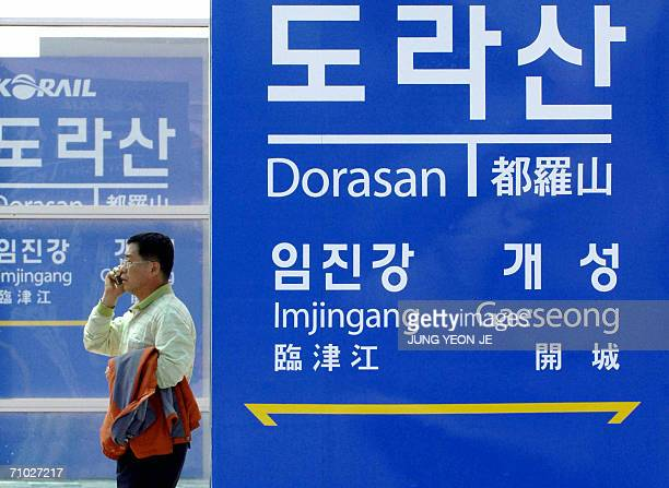 South Korean tourist talks on his mobile phone at Dorasan railway station just outside the southern boundary of the hevily fortified interKorean...