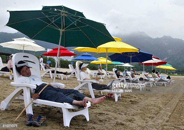 South Korean tourists rest along Kumgangsan beach in Kosung North Korea 03 July 2004 The beach opened in 2002 as part of an interKorean cooperative...