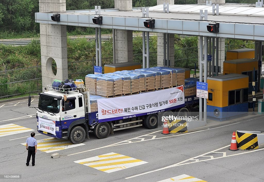South Korean trucks carrying 500 tons of flour for North Korean flood victims drive through the South's inter-Korean transit gate in Paju, north of Seoul, on September 21, 2021. A Seoul charity group sent flood aid to North Korea since the communist state was hit by a string of deadly floods and typhoons this summer.