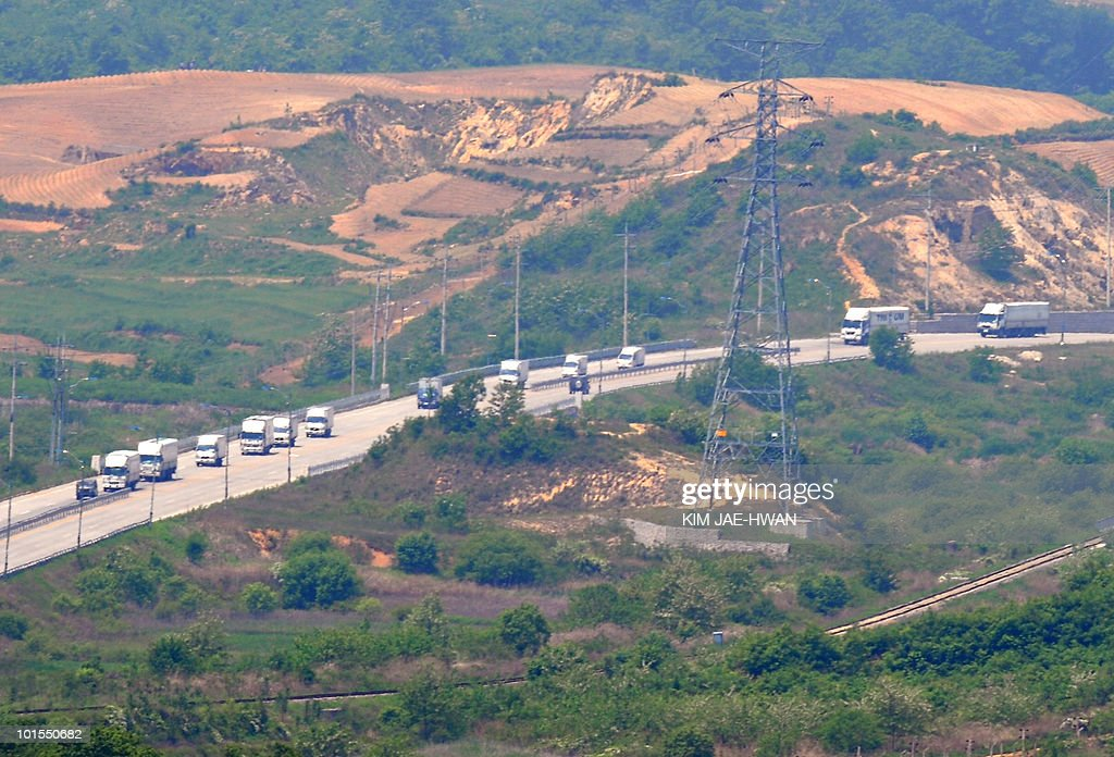 South Korean trucks, seen from a South Korean observation post in Paju, run down a cross-border road from a joint industrial estate for South Korean firms in Kaesong just north of the tense border on June 2, 2010. Cross-border tensions were running high over the sinking of a South Korean warship in March.